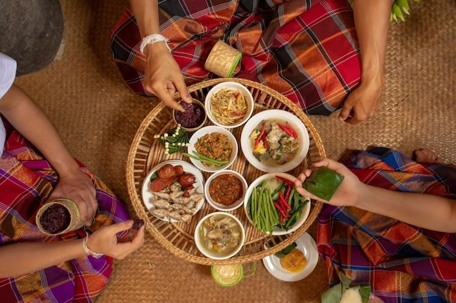 Photograph of an Isan meal in progress at the Life Community Museum in Beung Kan, Thailand.