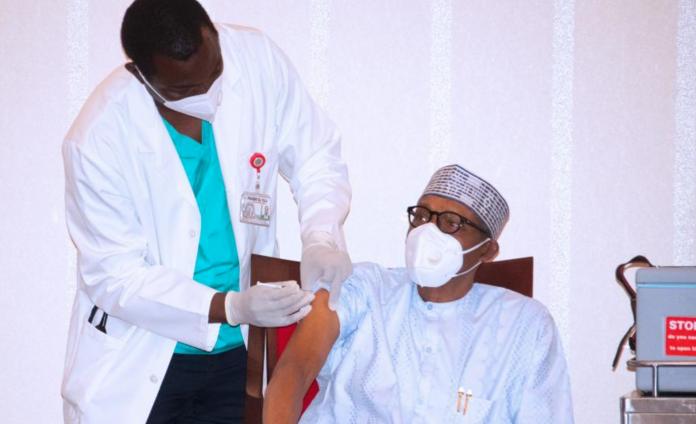 Nigerian President Muhammadu Buhari taking the COVID Vaccine