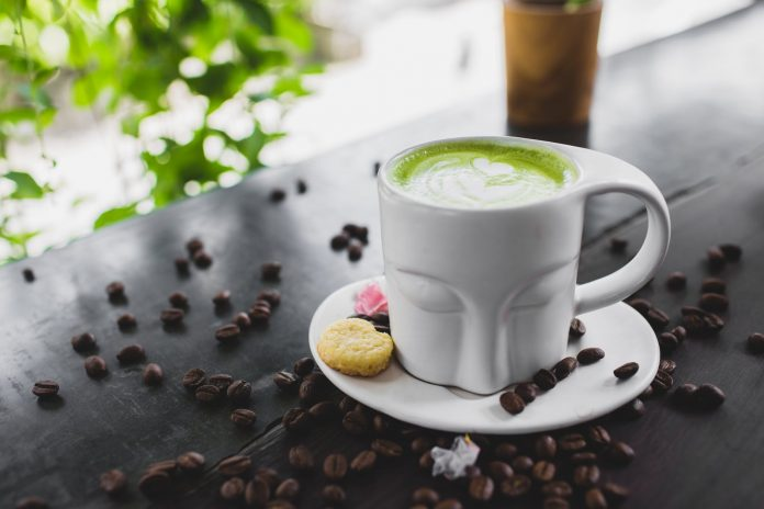 close up photo of matcha latte on a ceramic cup