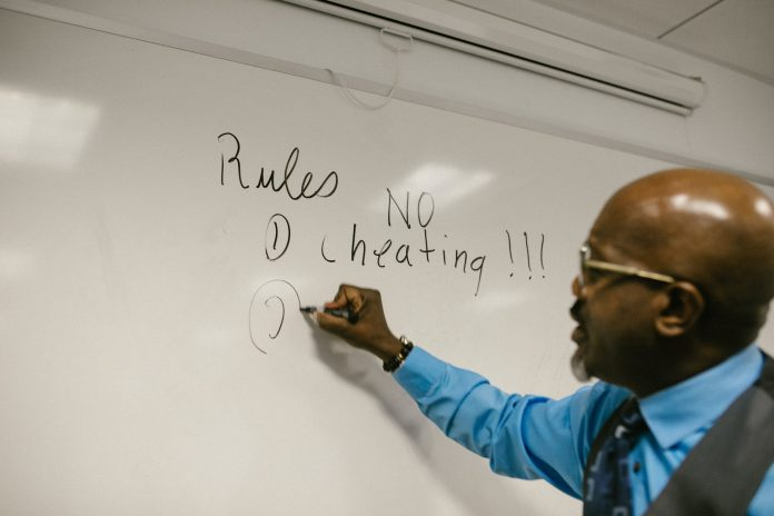teacher giving instructions not to cheat