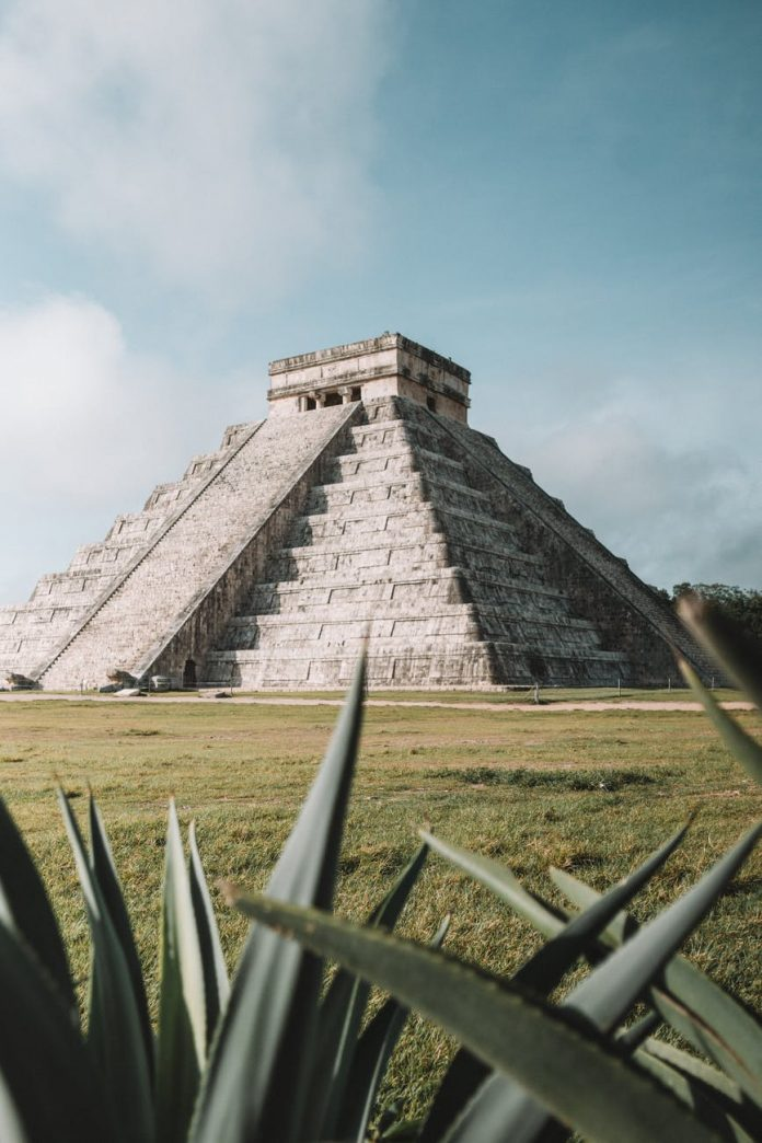 gray pyramid on grass field during day