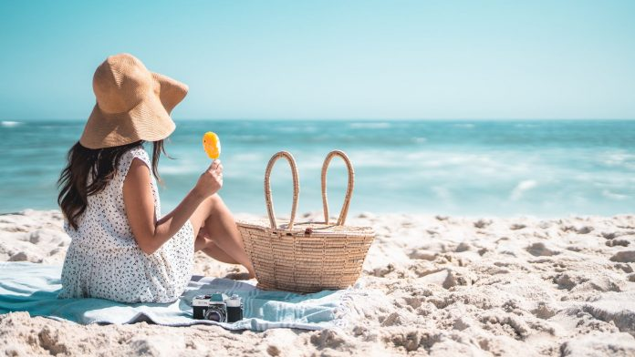 a woman relaxing at the beach