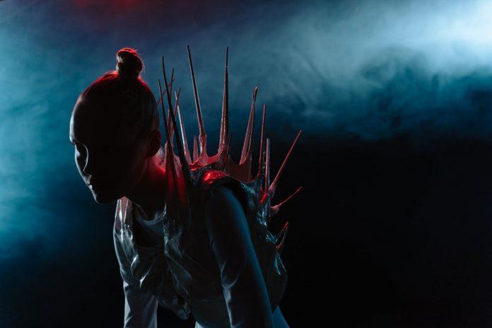 silhouette of woman wearing an alien costume