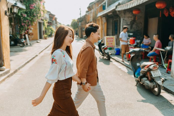 a couple holding hands while walking