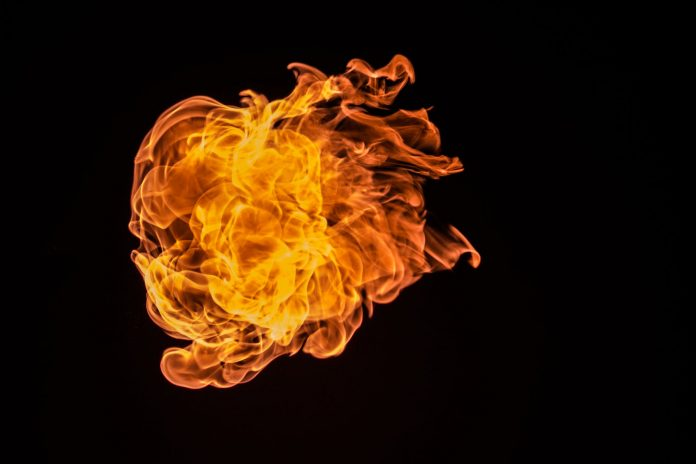 red fire with black background