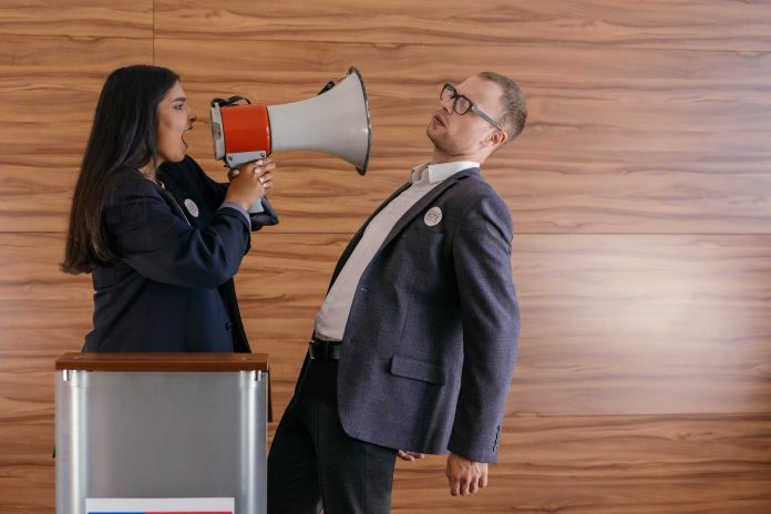 woman shouts on man using megaphone